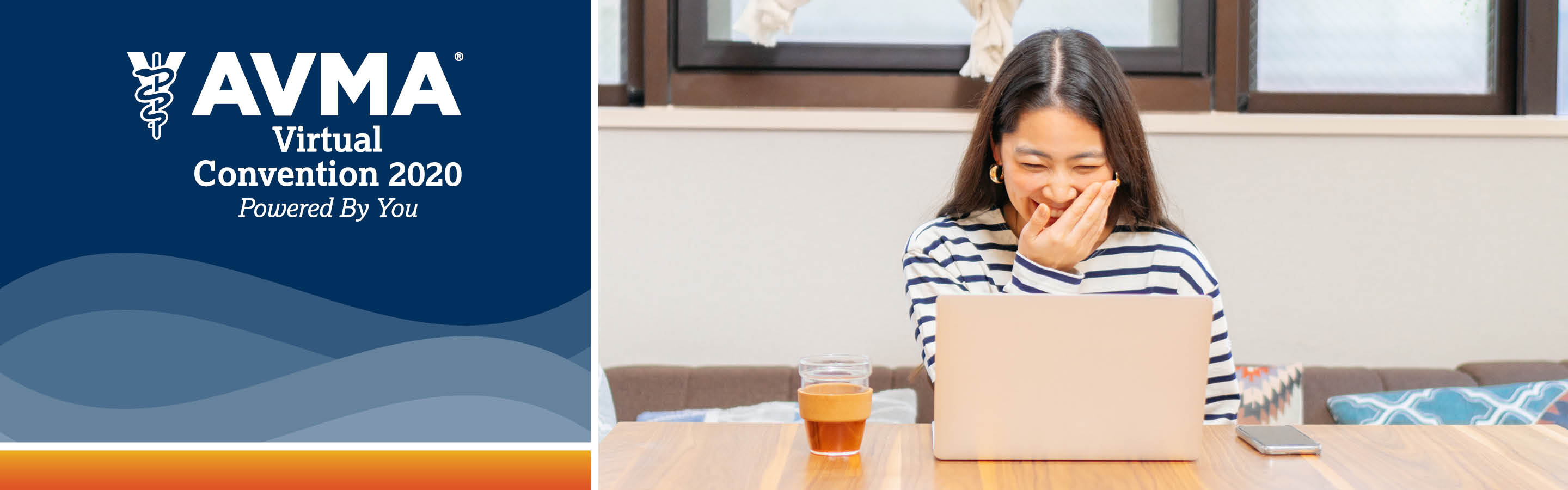 Woman laughing while looking at computer