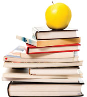 Golden apple on a stack of books