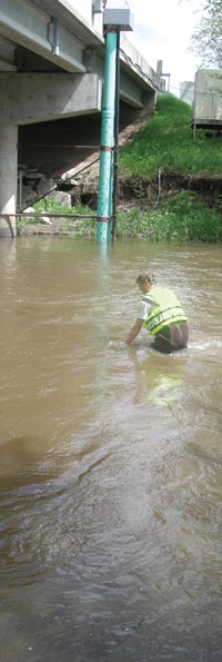 Scientist collecting water sample