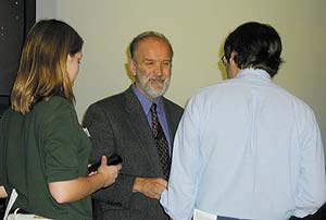 Dr. Peter Schantz, speaker from CDC, talks with students.