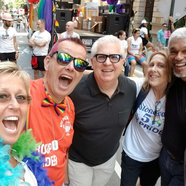 People celebrate together at a Pride Month parade