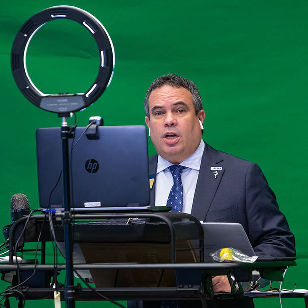 Dr. Jose Arce attending a virtual meeting of the AVMA House of Delegates