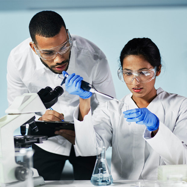 Two researchers in lab coats